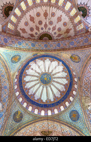 Embellished ornate domes of the Blue Mosque, Sultanahmet Camii or Sultan Ahmed Mosque in Istanbul, Republic of Turkey - Stock Photo
