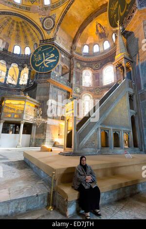 Muslim woman at Hagia Sophia, Ayasofya Muzesi, mosque museum  in Sultanahmet, Istanbul, Republic of Turkey - Stock Photo