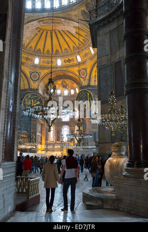 Tourists at Hagia Sophia, Ayasofya Muzesi, mosque museum in Sultanahmet, Istanbul, Republic of Turkey - Stock Photo