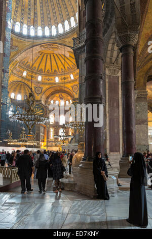 Muslim women at Hagia Sophia Ayasofya Muzesi mosque museum in niquab using smartphone to take photograph Istanbul, - Stock Photo