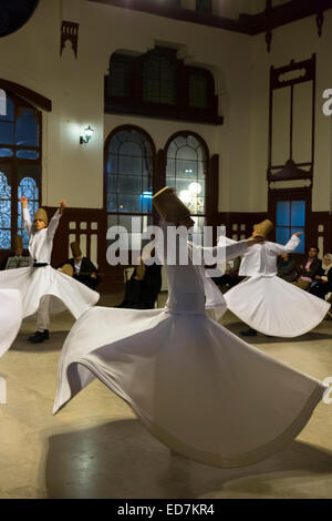 Whirling Dervish dance performance - Mevlevi Sema costume ceremony (whirling dervishes) in Istanbul, Republic of - Stock Photo