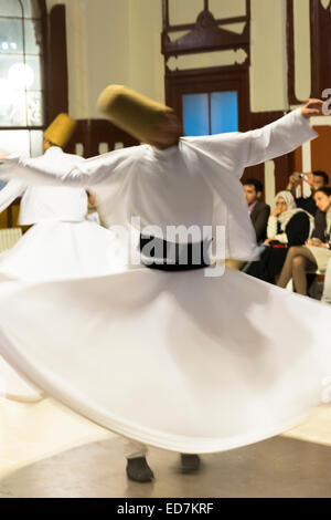 Tourists at Whirling Dervish ayin music performance - Mevlevi Sema - ceremony (whirling dervishes), Istanbul, Republic - Stock Photo