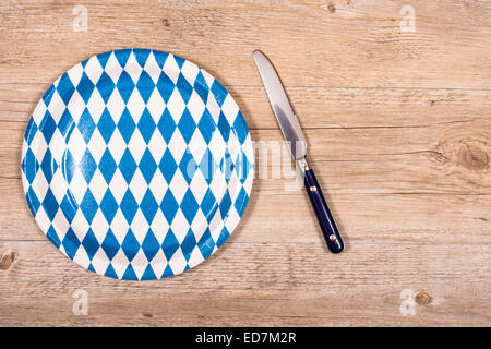 Bavarian light meal with knife and blue and white plate - Stock Photo