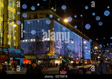 Shoppers in Oxford Street, Christmas Eve. - Stock Photo
