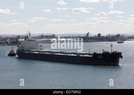 Bulk Carrier Nanaumi departing fully loaded with export coal from the Hunter Valley coal mines Newcastle NSW Australia. - Stock Photo