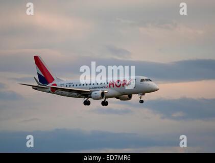 Hop (Air France) Embraer 170LR (ERJ-170 landing at Aberdeen Dyce Airport, Scotland.  SCO 9390. - Stock Photo