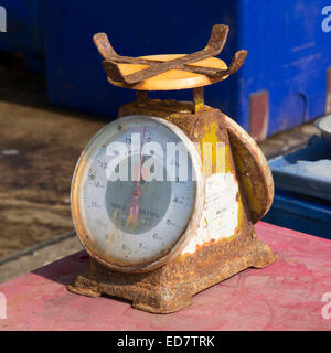 Rusting metal scales in use in a fish market at Hua Hin Thailand Asia - Stock Photo