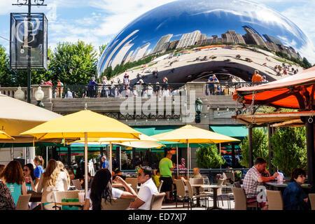 Chicago Illinois Loop Millennium Park Park Grill restaurant alfresco dining outdoor umbrellas yellow Cloud Gate - Stock Photo