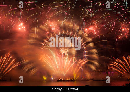 Westminster, Central London, UK 1st January 2015 Firework pyrotechnics from the London Eye Ushering in a New Year - Stock Photo