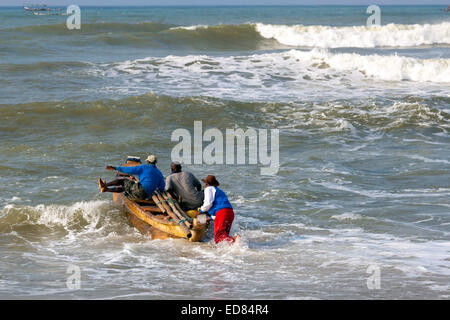 Fishing boat in rough water at Prampram, Greater Accra, Ghana, Africa - Stock Photo