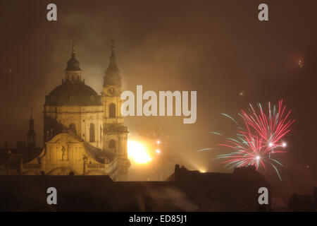 Prague, Czech Republic. 31st December 2014. New Year fireworks over Saint Nicholas' Church in Mala Strana in Prague, - Stock Photo
