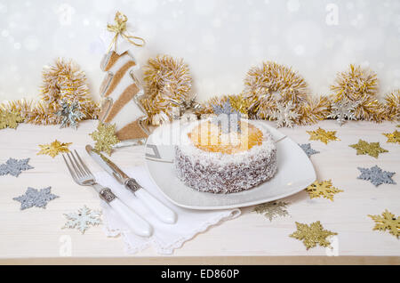 Festive pumpkin cake with coconut on table and Christmas decoration. Background bokeh. From series of Winter pastries - Stock Photo