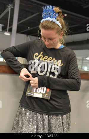 East Meadow, New York, USA. 31st Dec, 2014. LAURA SOFTY, of Bethpage, pins on her race bib identification, in preparation - Stock Photo