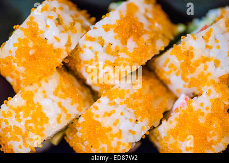Sushi plate with California Roll (springled with 'tobiko' fish roe) - Stock Photo