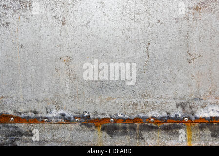 Zinc coated galvanized steel metal sheet plate pattern texture with rusty edges. - Stock Photo