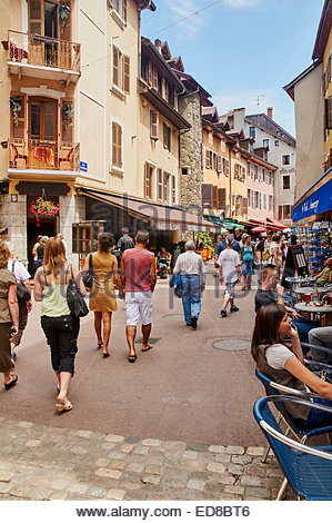 people walking and dining in rue perriere in the ancient french town of annecy france - Stock Photo