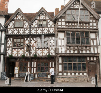 Female Standing Thoughtfully by Historic Building on the High Street in Stratford upon Avon in Warwickshire, England, - Stock Photo