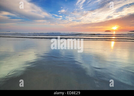 Sunset by the beach in Tanjung Aru Beach, Kota Kinabalu, Sabah Borneo, Malaysia. - Stock Photo
