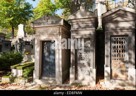 Père Lachaise Cemetery (Cimetière du Père-Lachaise) in autumn - mausoleums (family tombs) - Stock Photo