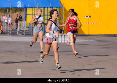 BENICASIM, SPAIN - JULY 19: People run to catch the first row after buying their tickets at FIB Festival. - Stock Photo