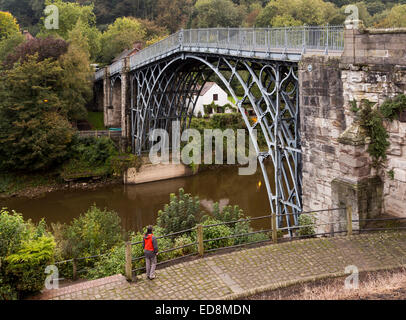 Person looking at the bridge over the river severn at Ironbridge, Shropshire, UK - Stock Photo