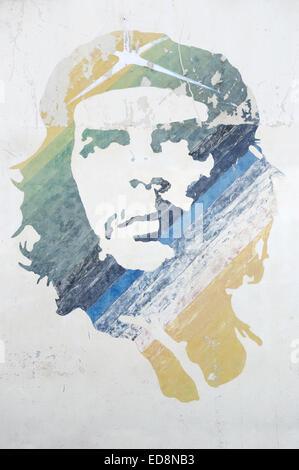 HAVANA, CUBA - JUNE 14, 2011: Graffiti stencil of revolutionary icon Che Guevara features stripes of color on a - Stock Photo