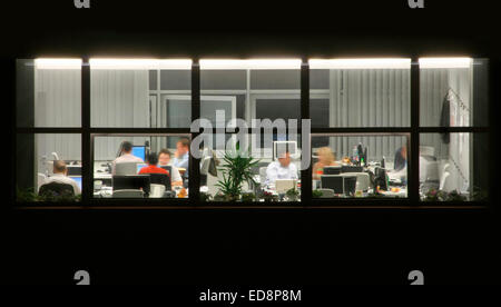 Late office work during deadline - Stock Photo