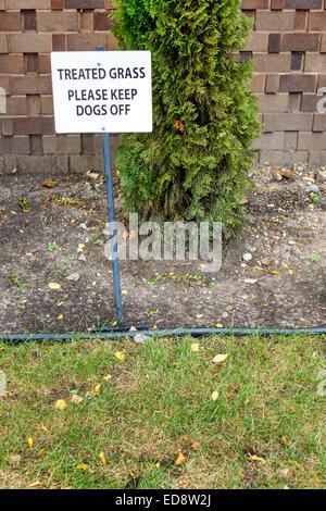 Illinois, Midwest, Chicago, Gold Coast historic District, neighborhood, garden, treated grass, sign, logo, herbicides, - Stock Photo