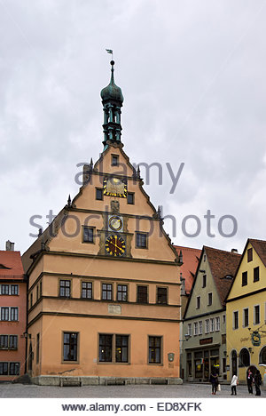 Tourists gather by Hotel Goldenes Lamm and Ehemaliges Ratstrinkstube, Marktplatz of Rothenburg ob der Tauber, Bavaria, - Stock Photo