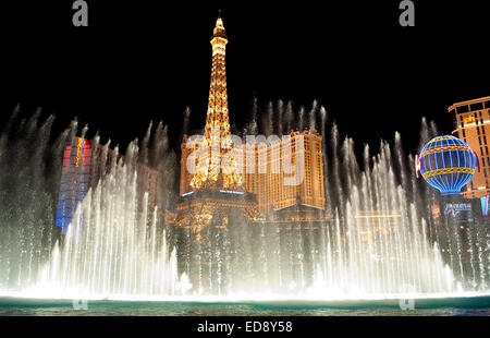 Las Vegas Boulevard by night with Paris Las Vegas and Bally's hotels and casinos as seen over the lake at Bellagio. - Stock Photo