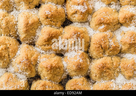 Small homemade Balkan dessert with coconuts on a black tray - Stock Photo