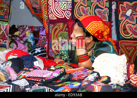 Kuna indian crafts on display and on sale in a street of Panama city - Stock Photo