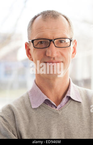 Closeup portrait of casual style adult man in glasses - Stock Photo