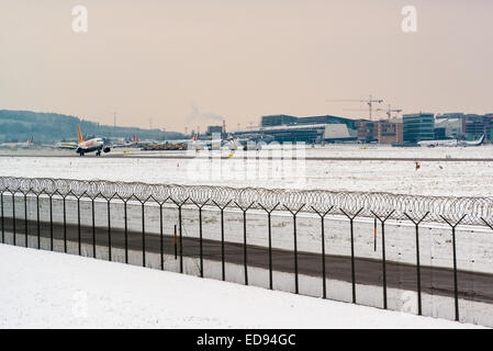 STUTTGART, GERMANY- DECEMBER 28, 2014: A Pegasus airplane is departing Stuttgart Airport on a frosty winter day - Stock Photo