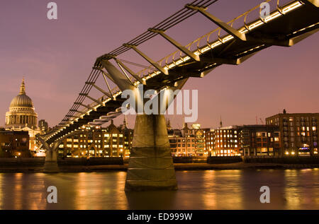 A night shot of the Millennium Bridge and St. Paul's Cathedral, London, from the South Bank of the River Thames - Stock Photo