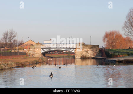 A bridge crosses the Leeds and Liverpool Canal near Stanley Dock in Liverpool - Stock Photo
