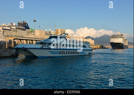 Passenger ferry and cruise ship 'MS Noordam' in the port at Naples with Vesuvius behind. Naples, Campania, Italy - Stock Photo