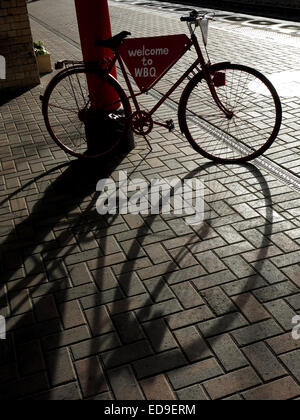 Welcome to Warrington Bank Quay Railway Station, Cheshire, England UK bike in shadow - Stock Photo