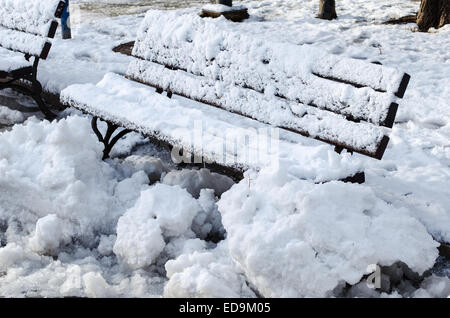 Wooden frosted bench in Russe Bulgaria closeup view - Stock Photo
