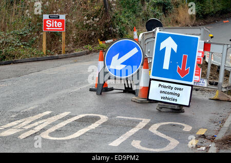 Roadsigns at a bridge under repair (Maidstone, England) Priority over oncoming vehicles - Stock Photo