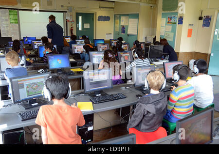 children learning in a british london ICT class room - Stock Photo