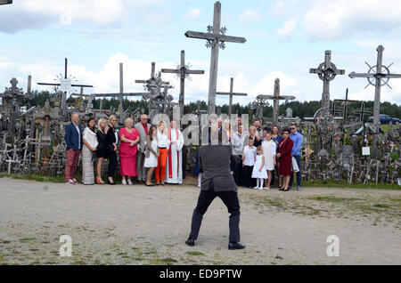 The Hill of Crosses in Lithuania crosses catholic shrine wedding party - Stock Photo