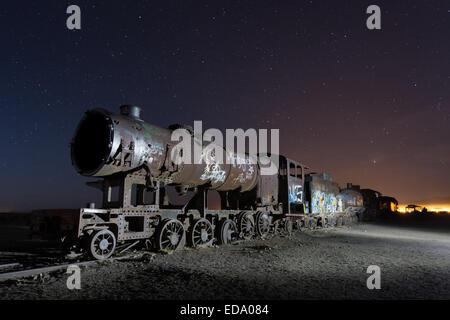 Night at train cemetery in Uyuni, Bolivia, South America - Stock Photo