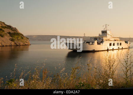 Car ferry to Pag island in sunset, Croatia - Stock Photo