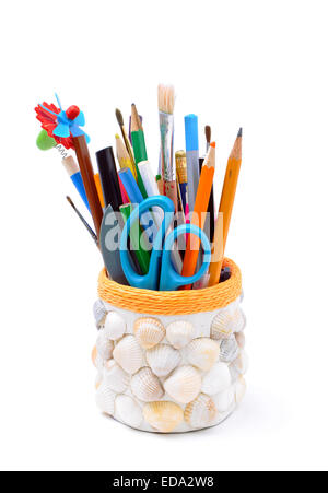 pencils, brushes, plastic knife, scissors in handmade pencil-box isolated - Stock Photo