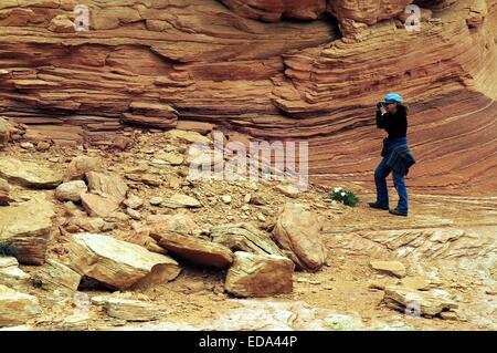 Jo, photographing the 'waves' of sandstone near Page, Arizona - USA.