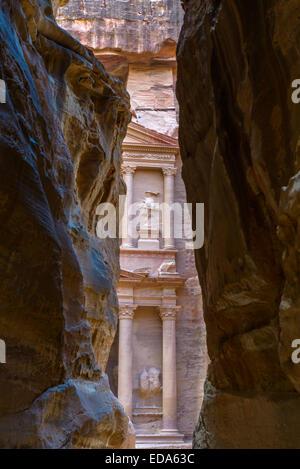 The Khazneh (Treasury) seen from the Siq, Petra, Jordan. - Stock Photo
