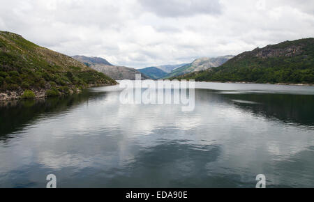 Reflection of the spring sky on the Lima river meandering through Peneda Geres, the only national park in Portugal. - Stock Photo