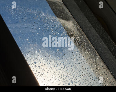 the sun shines through  drops of water - Stock Photo