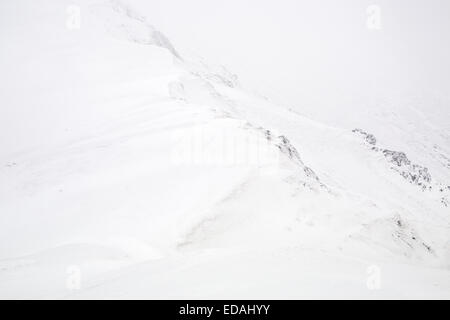 Snow covered rock detail on mountain side of Blencathra, Keswick, Cumbria Lake District - Stock Photo